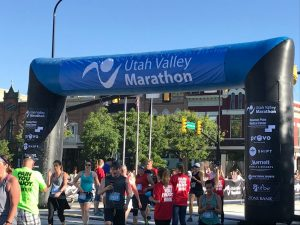 Crossing the Utah Valley 10k finish line