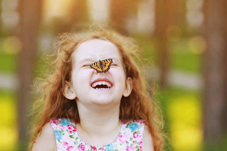 Laughing girl with butterfly