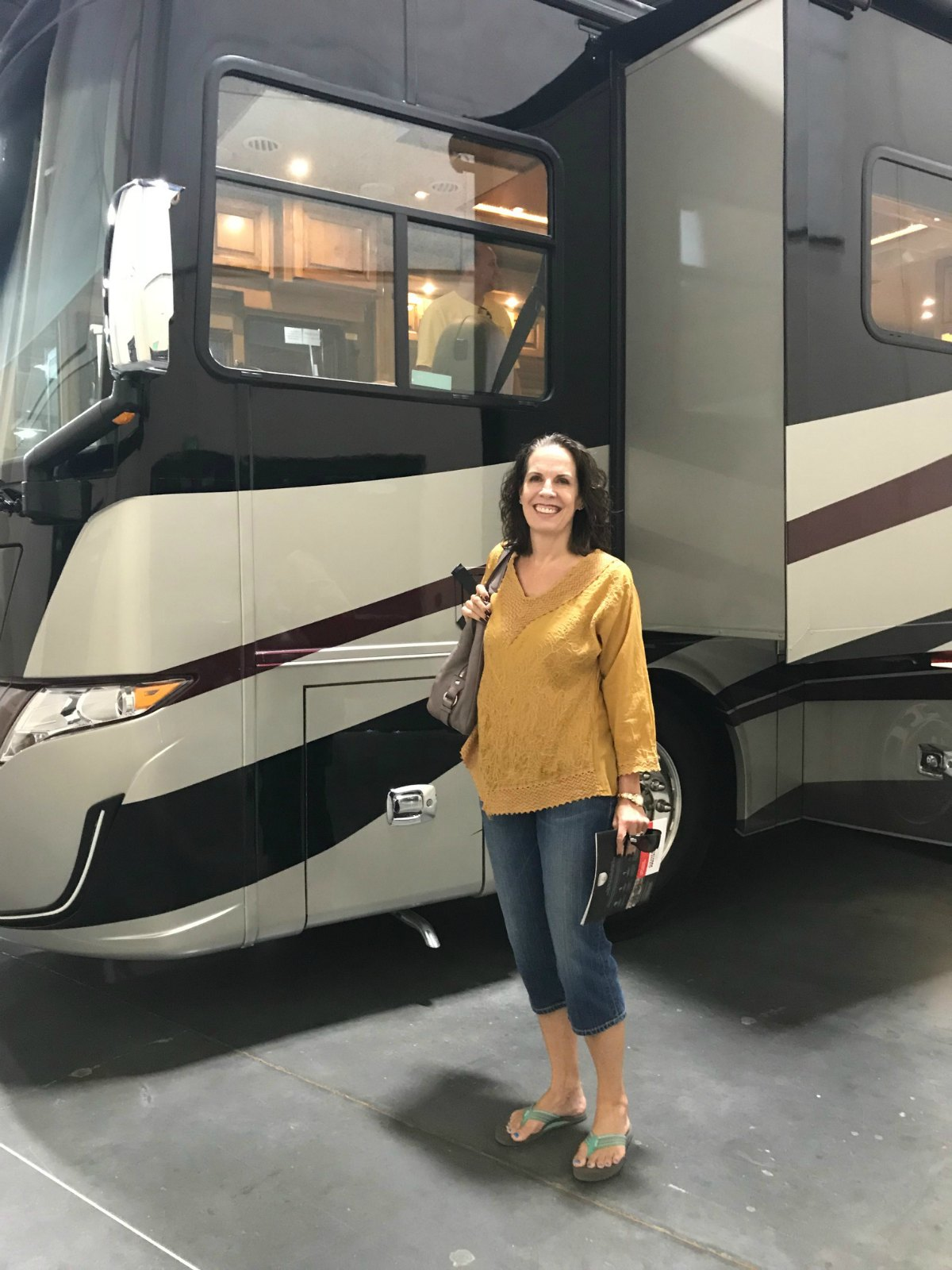 Woman in front of a motorhome