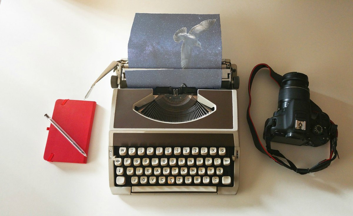 Notebook, typewriter, and camera