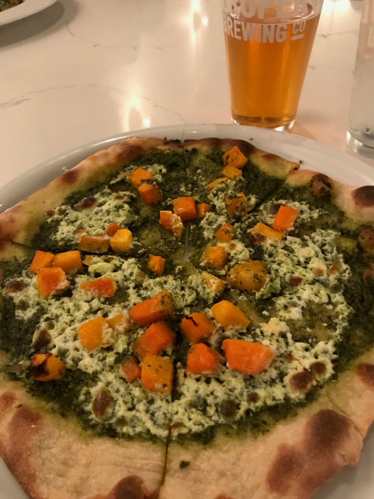 Smoked ricotta pesto pizza