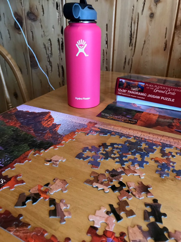 Jigsaw puzzle and water bottle.