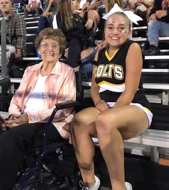 Grandmother and granddaughter at a football game.