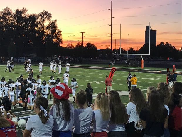 Sunset at high school football game.