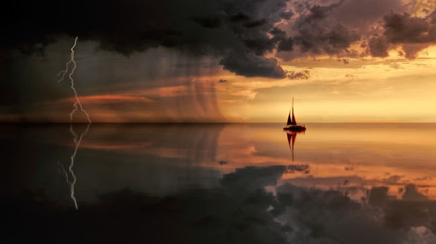 Boat in a storm at sunset.