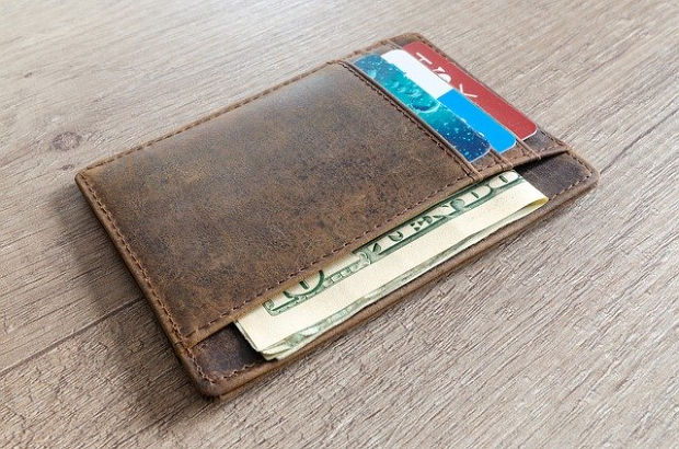 A wallet with cards and cash.