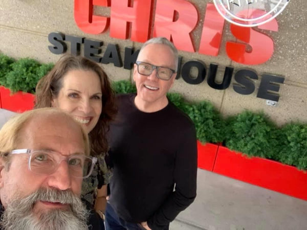 Three friends in front of Ruth's Chris Steakhouse.